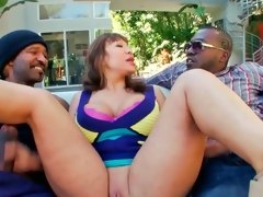 Two guys with huge dicks are fucking a hot milf