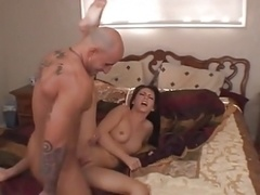 Screaming brunette fucked on the bed