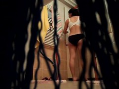 Hot chick gets secretly filmed while changing her hot cloth