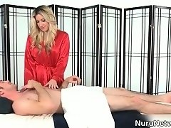 Nudist Japanese soccer mom fingered to extasy on massage bed