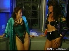 Two aroused lesbians has an intercourse on kitchen