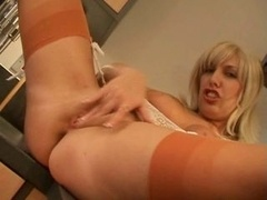 British whore Sandie Caine fingers herself in the kitchen