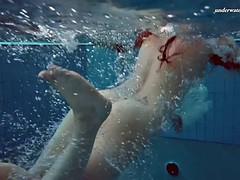 redhead hottie liza bubarek undresses her swimsuit underwater