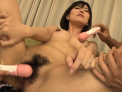 Asian licks her mambos while fondling her hairy pussy