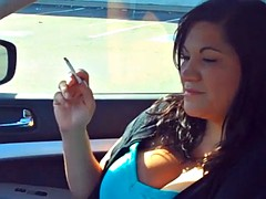 woman smoking in car 1