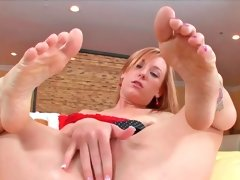 Cute blonde Dani massages a hard cock with her feet
