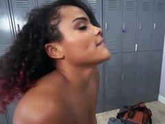 A big black dude is fucking an ebony chick in the locker room