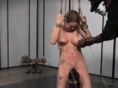 Hogtied busty slave tormented by black dom