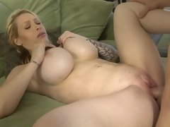 A hot blonde with large boobs is getting a dick in her sexy cunt