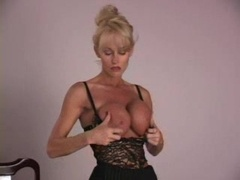 Busty Milf Teases With Vibrator
