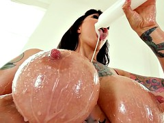 milf dollie darko pours lube all over her big juggs