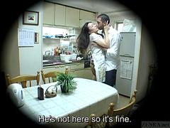 A voyeur watching an Asian milf getting fucked in the kitchen