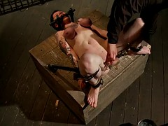 bondage girl's titties go purple from being tied tight