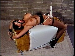 Babe tied with vibrator attached to pussy orgasms