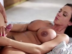 A milf is getting her cunt licked by a guy with blonde short hair