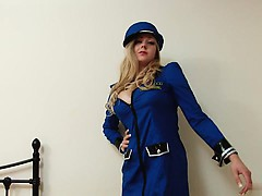 Busty policewoman strips and fingerfucks her pussy