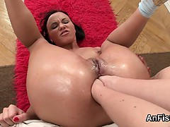 Unusual lesbo stunners are stretching and fist fucking butt