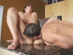 mom bang boy in kitchen