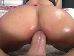 A woman that has a huge ass is getting a dick shoved into her