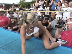 Playful young blonde takes out her tits before stepping into the ring