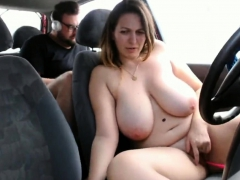 Woman with big tits masturbates in a car