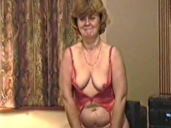 Mature tenderly dances and strips down on camera
