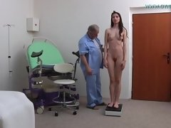 Brunette girl spreads her long legs during gyno pussy exam